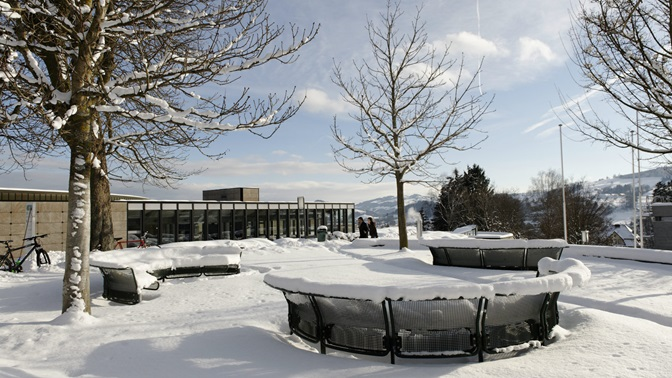 Winter wonderland at the University of St.Gallen (HSG), square in front of the Library Building