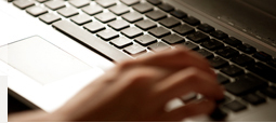 A person tiping on a computer keyboard