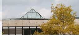 The library building from outside with the pyramid in the middle